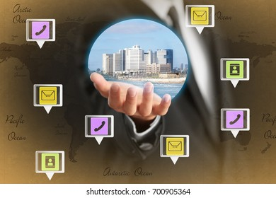 Businessperson holding media image of futuristic city on hand. Modern technology concept
