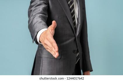 Businessperson lending a hand.