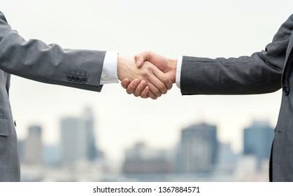 Businessperson shaking hands.