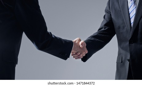 Businessperson shaking hands. Business connection concept.