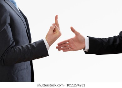 Businessperson Showing Fuck Off With The Middle Finger To The Colleague Shaking Hand