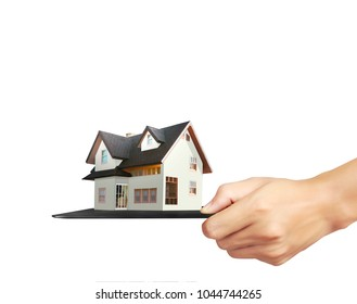 Business's hand holds house model made