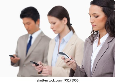 Businessteam looking at their cellphones against a white background