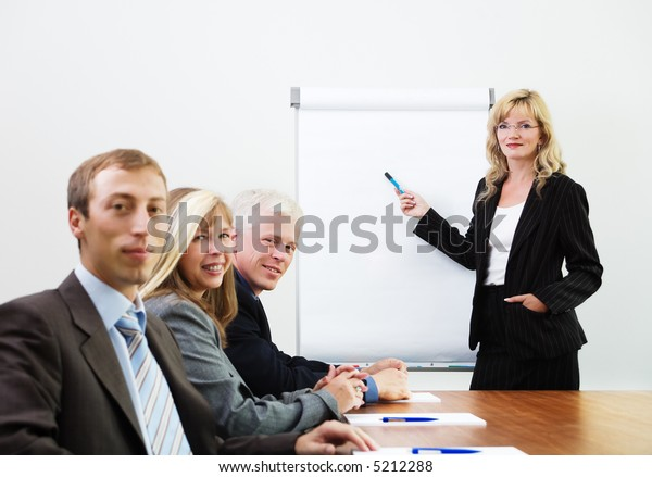 Businessteam in a presentation, looking at the viewer (focus on lecturer)
