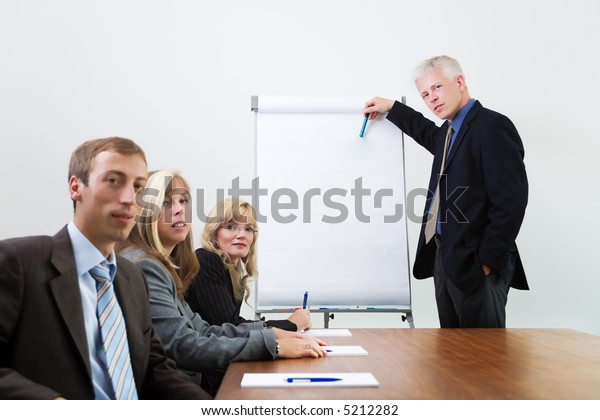 Businessteam in a presentation situation (focus on lecturer)