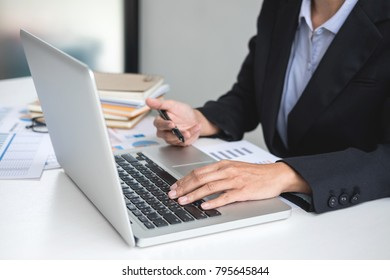 Businesswoman or accountant working Financial investment on calculator with calculate Analyze business and market growth on financial document data graph and writing ,Accounting,Economic,commercial.