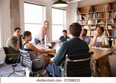 Businesswoman Addressing Team Meeting Around Table