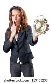 Businesswoman with alarm clock on white