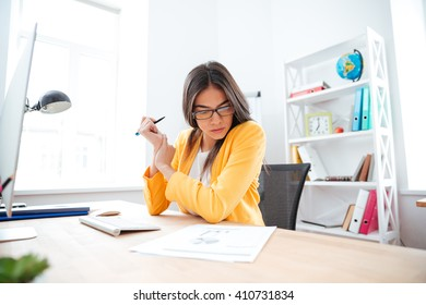 Businesswoman analysing document in office