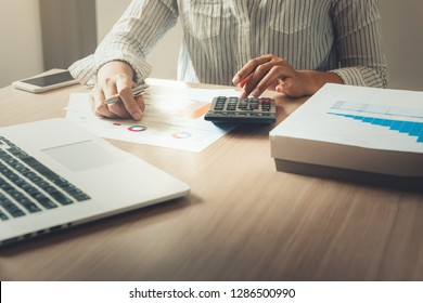 Businesswoman is analyzing of financial and planning calculation for investment on table desktop., Accounting tax document information for balancing budget and profit income., Business and strategy .