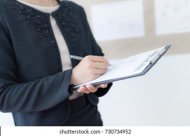 Businesswoman analyzing her project on board