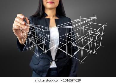 Businesswoman (Architect / Interior designer) drawing 3D home on modern futuristic virtual screen