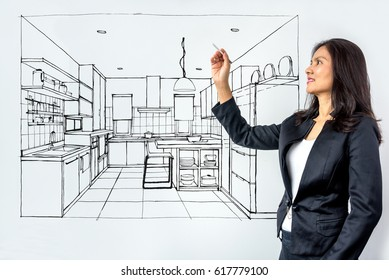Businesswoman (Architect / Interior designer) working with modern futuristic virtual drawing home / Future technology concept