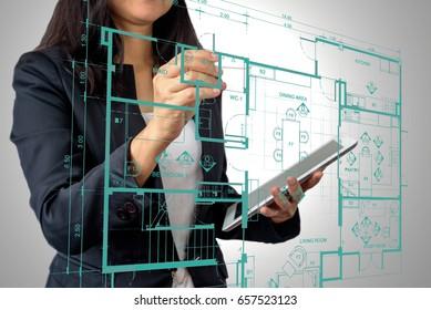 Businesswoman (Architect / Interior designer) working with modern futuristic virtual layout home