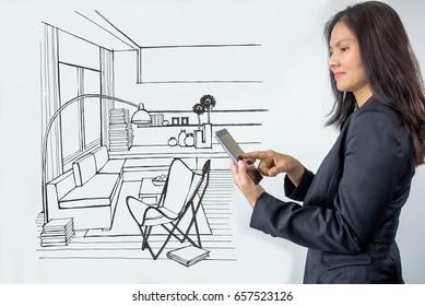 Businesswoman (Architect / Interior designer) working with modern futuristic virtual drawing home