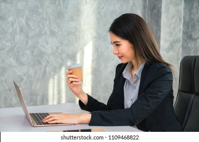 Businesswoman asia drinking coffee at desk after overwork.