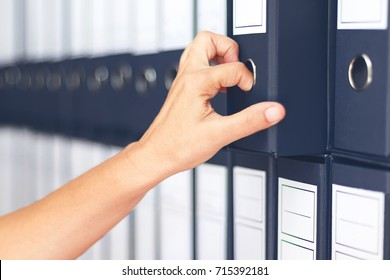 Businesswoman binders Female accountant archiving business documentation