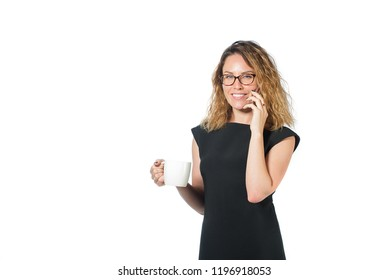 businesswoman in black dress happy face. Beautiful sexy brunette woman business. business woman is negotiating by phone looking at a report in a folder holding a mug of coffee looking at a laptop