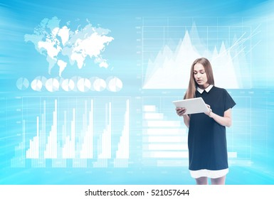 Businesswoman in black and white dress is looking at her tablet while standing in room with holograms. Double exposure. Elements of this image furnished by NASA