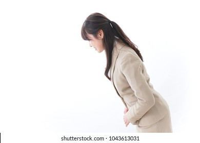 Businesswoman bowing her greetings