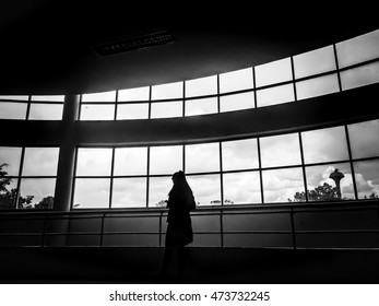Businesswoman in building [silhouette]