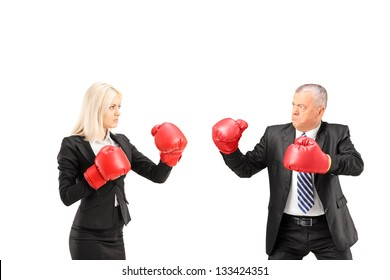 Businesswoman and businessman with boxing gloves having a fight isolated on white background