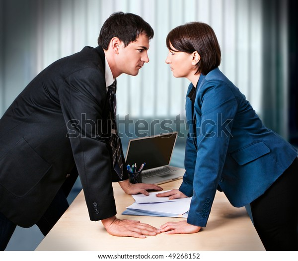 businesswoman and businessman are fighting