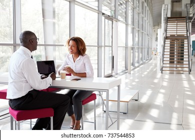 Businesswoman and businessman at a meeting, talking