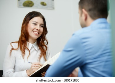 Businesswoman with businessman at office