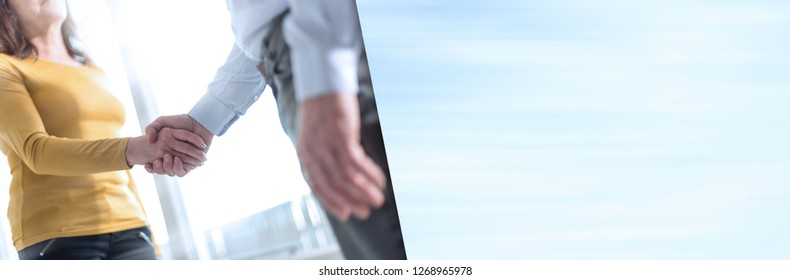 Businesswoman and businessman shaking hands in office. panoramic banner