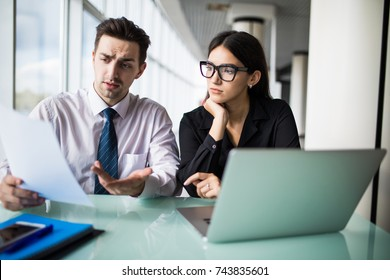 Businesswoman and businessman talking at work in office