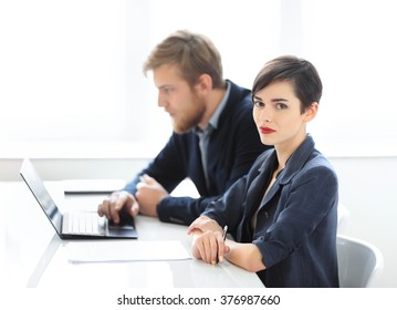 Businesswoman and businessman working together in the office
