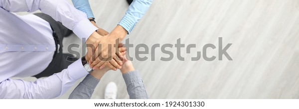 Businesswoman and businessmen are standing with their hands together. Successful businessmen teamwork and business agreement concept