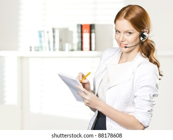 businesswoman call with headset  in office