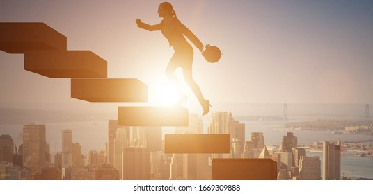 Businesswoman in career growth concept with stairs