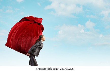 Businesswoman carrying big red bag on back