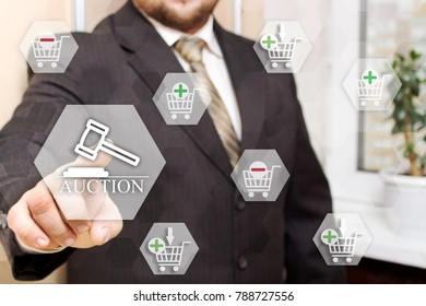 The businesswoman chooses an online auctions, presses a button on the touch screen in the global network. Ecommerce. Shopping at the online store.
