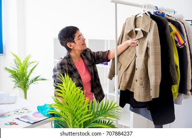 Businesswoman choosing clothes