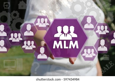 The businesswoman clicks the button MLM on the touch screen .The concept of multi-level marketing.