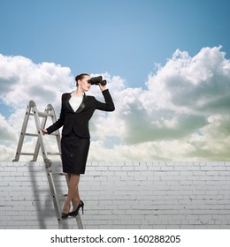 businesswoman climbed a ladder and looking through binoculars