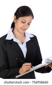 Businesswoman with clip board