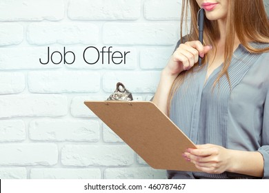 businesswoman with clipboard and pen making notes and standing near text - job offer