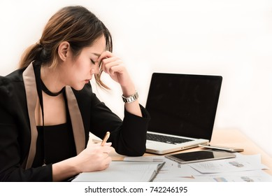 businesswoman closed her eyes for rest and relax because feeling stressed after hard work all day.