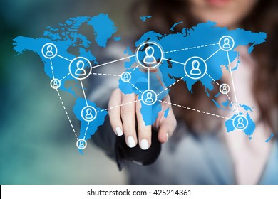 Businesswoman connecting worldwide social network scheme on virtual touch screen.