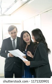 Businesswoman consult with her boss. Female business leader talking with her colleagues at the meeting.