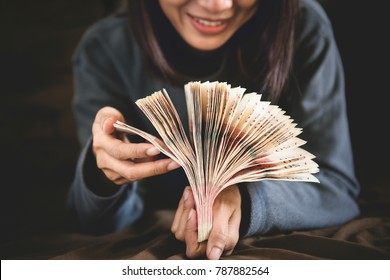 Businesswoman counting cash money , Woman counting money , Stack of Money in hand , business and income concept.