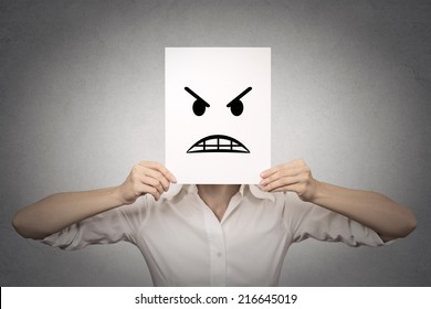 businesswoman covering her face with angry mask isolated grey wall background. Negative emotions, feelings, expressions, body language