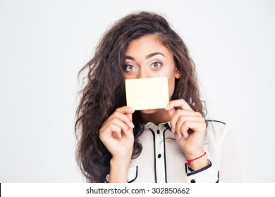 Businesswoman covering her mouth with blank card isolated on a white background