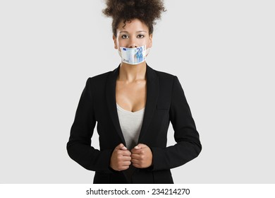 Businesswoman covering her mouth with a euro banknote, great concept for the global crises