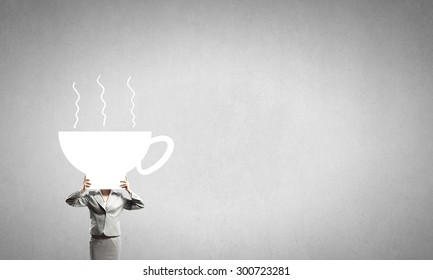 Businesswoman with cup of coffee or tea instead of her head